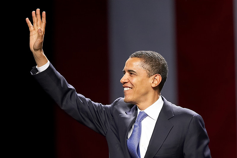 U.S. presidential hopeful and Senator Barack Obama waves to the crowd as he enters the Agannis Arena in Boston, Mass. for his New England kickoff rally, Friday, April 20, 2007.
