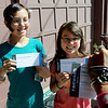 "Suscha Walker, left, and her sister Ilah, are photographed holding the Obama tickets they just received.<br /> Hundreds of people waited in line outside the Obama Organizing for America Office on Pearl Street to get tickets to  President Obama's speaking engagement at CU on Sunday.<br /> For a video and more photos, go to  <a href=""http://www.dailycamera.com"">http://www.dailycamera.com</a>.<br /> Cliff Grassmick  / August 30, 2012"