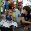 "Pam McDonald reads to her grandchildren, Naimi Ponti and Matteo Ponti, while waiting in line to get Obama tickets for the visit Sunday in Boulder.<br /> Hundreds of people waited in line outside the Obama Organizing for America Office on Pearl Street to get tickets to  President Obama's speaking engagement at CU on Sunday.<br /> For a video and more photos, go to  <a href=""http://www.dailycamera.com"">http://www.dailycamera.com</a>.<br /> Cliff Grassmick  / August 30, 2012"