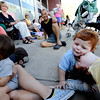 "Ness Nayer, right, kisses his  brother, Max, while waiting in line  for tickets to see President Obama in Boulder on Sunday. Xavi Rivera is on the left with his mother Liza Pascal.<br /> Hundreds of people waited in line outside the Obama Organizing for America Office on Pearl Street to get tickets to  President Obama's speaking engagement at CU on Sunday.<br /> For a video and more photos, go to  <a href=""http://www.dailycamera.com"">http://www.dailycamera.com</a>.<br /> Cliff Grassmick  / August 30, 2012"