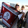 "Diane Wagner, holding an Obama momento she bought in Tanzania, while waiting in line for Obama tickets.<br /> Hundreds of people waited in line outside the Obama Organizing for America Office on Pearl Street to get tickets to  President Obama's speaking engagement at CU on Sunday.<br /> For a video and more photos, go to  <a href=""http://www.dailycamera.com"">http://www.dailycamera.com</a>.<br /> Cliff Grassmick  / August 30, 2012"