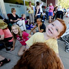"Ness Nayer gets tickled by his mother, Danielle Pascal, while waiting in line to get tickets to see President Obama in Boulder on Sunday.<br /> Hundreds of people waited in line outside the Obama Organizing for America Office on Pearl Street to get tickets to  President Obama's speaking engagement at CU on Sunday.<br /> For a video and more photos, go to  <a href=""http://www.dailycamera.com"">http://www.dailycamera.com</a>.<br /> Cliff Grassmick  / August 30, 2012"