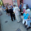 "Sandra Hollander, bottom right, and her husband, Robert McCrea, wait in line for tickets to see President Obama in Boulder on Sunday.<br /> Hundreds of people waited in line outside the Obama Organizing for America Office on Pearl Street to get tickets to  President Obama's speaking engagement at CU on Sunday.<br /> For a video and more photos, go to  <a href=""http://www.dailycamera.com"">http://www.dailycamera.com</a>.<br /> Cliff Grassmick  / August 30, 2012"