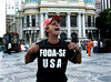 """A activist protests against the visit of Barack Obama in Cinelandia square where the US President will speak next sunday 20, Rio de Janeiro, Brazil, march 17, 2011. In the T-shirt says: """"US Fuck off"""". (Austral Foto/Renzo Gostoli)"""