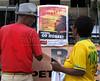 Activists observe banners against the visit of Barack Obama to Rio de Janeiro, in Cinelandia square where the US President will speak next sunday 20, Rio de Janeiro, Brazil, march 17, 2011.  (Austral Foto/Renzo Gostoli)
