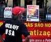 A activist looks banners against the visit of Barack Obama to Rio de Janeiro, in Cinelandia square where the US President will speak next sunday 20, Rio de Janeiro, Brazil, march 17, 2011. (Austral Foto/Renzo Gostoli)
