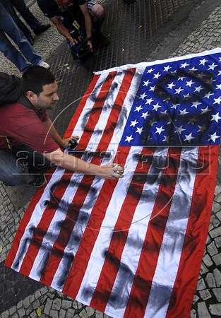A activist protests against the visit of Barack Obama in Candelaria square, Rio de Janeiro, Brazil, march 18, 2011.  (Austral Foto/Renzo Gostoli)