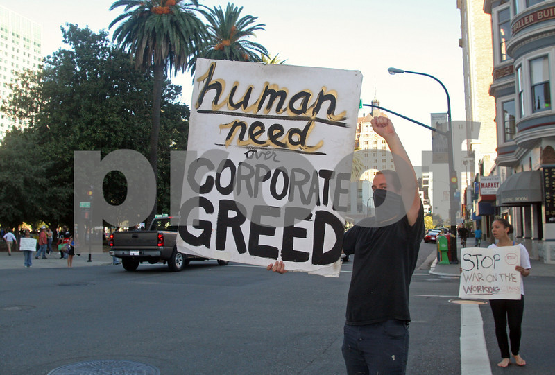 Occupy Sacramento demonstrators at Cesar Chavez Plaza Park try to get passing vehicles to honk in support in Sacramento, California on October 8, 2011. Photo by David Yee ©2011