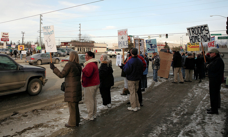 Vigilant citizens gather on the corner of Benson and the Seward Highway on March 19th, 2008, to promote peace and urge an end to the occupation of Iraq.