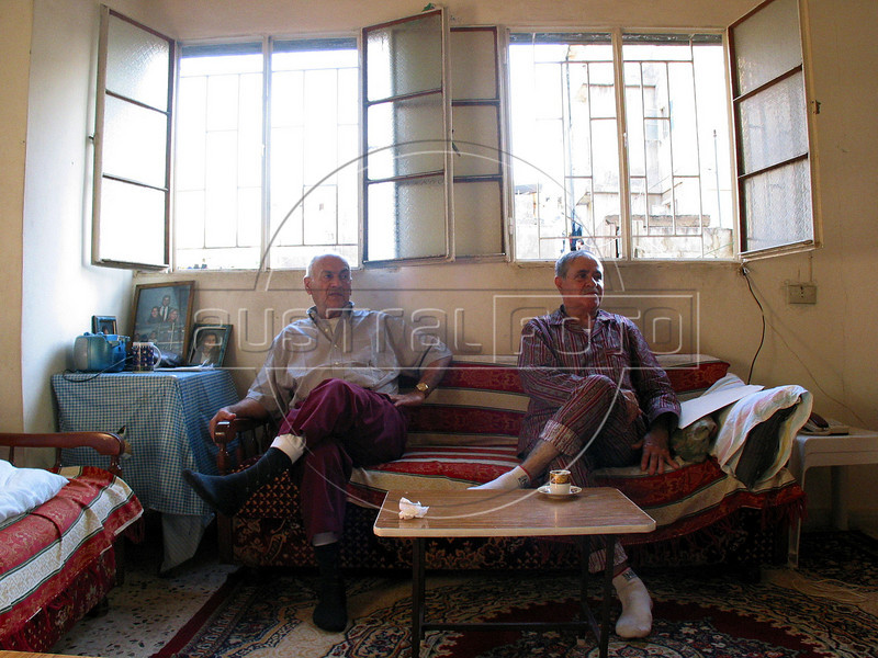 Men relax on a couch in their home at the Shatila Palestinian refugee camp in Beirut, Lebanon. Shatila and another camp were site of an infamous massacre of more than 1000 people in 1982 by Christian milita members as Israeli soldiers stood by. The UN estimates over 300,000 Palestinian refugess in Lebanon, who are denied many services and banned from working in many occupations.(Australfoto/Douglas Engle)