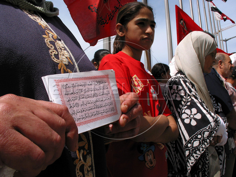 """A Palestinian woman holds the Koran during a peaceful protest in front of the United Nations Economic and Social Comission of West Asia Building (UN-ESCWA) in Beirut, Lebanon to mark the 55th anniversary of their plight, known as nakba, or """"great catastrophe."""" The UN estimates over 300,000 Palestinian refugess in Lebanon, who are denied many services and banned from working in many occupations.(Australfoto/Douglas Engle)"""