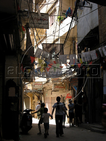 Children walk through the narrow streets of the Shatila Palestinian refugee camp in Beirut, Lebanon. Shatila and another camp were site of an infamous massacre of more than 1000 people in 1982 by Christian milita members as Israeli soldiers stood by. The UN estimates over 300,000 Palestinian refugess in Lebanon, who are denied many services and banned from working in many occupations.(Australfoto/Douglas Engle)