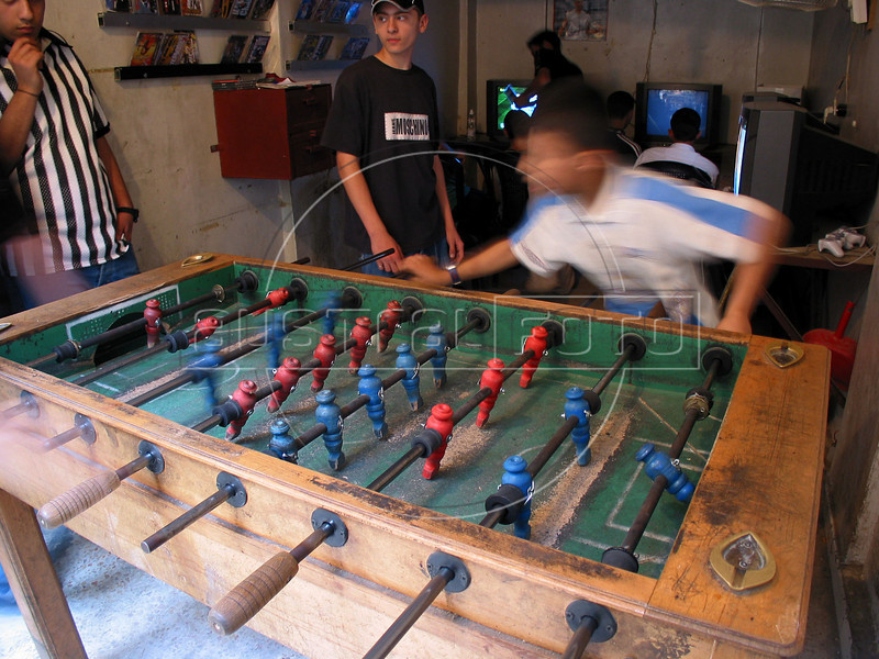 Boys play at a game center at the Shatila Palestinian refugee camp in Beirut, Lebanon. Shatila and another camp were site of an infamous massacre of more than 1000 people in 1982 by Christian milita members as Israeli soldiers stood by. The UN estimates over 300,000 Palestinian refugess in Lebanon, who are denied many services and banned from working in many occupations.(Australfoto/Douglas Engle)