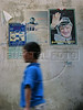 A boy walks past a poster of Palestinian leader Yasser Arafat at the Shatila Palestinian refugee camp in Beirut, Lebanon. Shatila and another camp were site of an infamous massacre of more than 1000 people in 1982 by Christina milita members as Israeli soldiers stood by. The UN estimates over 300,000 Palestinian refugess in Lebanon, who are denied many services and banned from working in many occupations.(Australfoto/Douglas Engle)