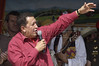 Venezuelan President Hugo Chavez speaks to peasants on a communal farm near Tapes, about 80 miles south of Porto Alegre, Brazil, Jan. 30, 2005. Chavez visited the farm during his participation in the World Social Forum, timed to coincide with its nemesis, the World Economic Forum held thousands of kilometers (miles) away in the swank Swiss mountain resort of Davos. (AustralFoto/Douglas Engle)