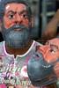 A street vendor wears a mask of Brazilian Presidential Cantidate Luis Inacio Lula da Silva while selling them in Rio de Janeiro on the eve of the Presidential election.(Australfoto/Douglas Engle)