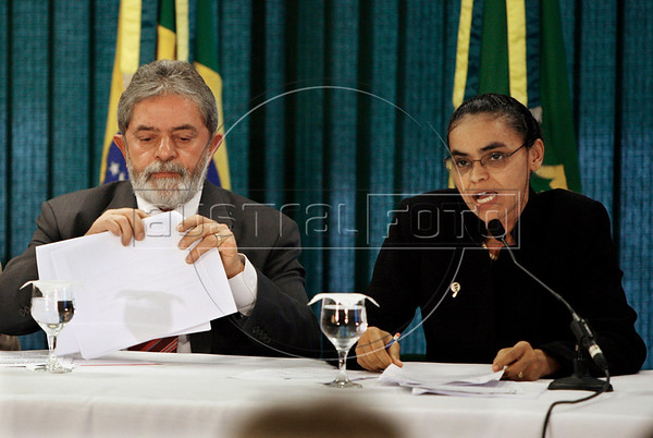"""Brazilian President Luiz Inacio Lula da Silva looks on as Marina Silva, his Environment Minister, delivers remarks about the Amazon rain forest during a meeting at Planalto Palace in Brasilia. Silva - no relation to President Lula da Silva - resigned her position on May 13, 2008. Silva, who was looked at as a champion of environmentalists but scorned by powerful farming groups, said she stepped down due to difficulties she faced """"in carrying out the national environment agenda."""" A devoted defender of the Amazon rain forest and close ally of the president, Silva held her post since Lula took office in 2003.  (AustralFoto)"""