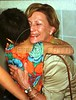 Norwegian Queen Sonja hugs a girls at a shelter for unwed women in Itaborai, Brazil. Sonja is in Brazil on a seven day official visit.(Douglas Engle/Australfoto)