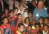 Norwegian Queen Sonja, back center,  and Norwegian King Harald, back right,  stand with children in a slum of Rio de Janeiro. The Royal couple is on a seven day official visit to Brazil.(Douglas Engle/Australfoto)