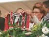 Norwegian Queen Sonja, holds up a Fluminense football team jersey during an event to commission a ship by a Norwegian company at a shipyard in Niteroi, Brazil.(Douglas Engle/Australfoto)