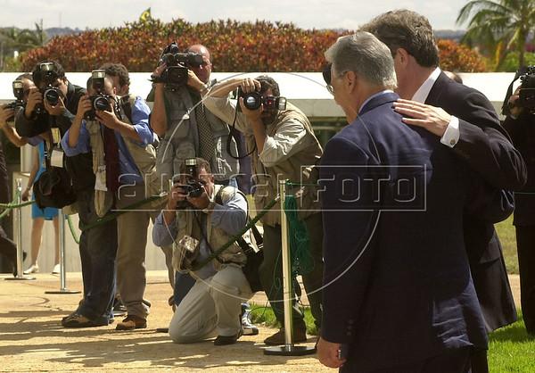 Brazilian President Fernando Henrique Cardoso walks with British Prime Minister Tony Blair as press photographers struggle to get a picture in Brasilia, Brazil. (Douglas Engle/Australfoto)
