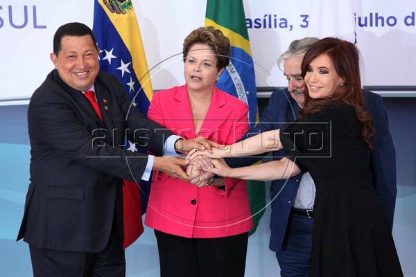Hugo Chavez of Venezuela, Dilma Rousseff of Brazil, Jose Mujica of Uruguay and Cristina Kirchner of Argentina pose for an official photo at the Planalto Palace, in Brasilia July 31, 2012, for the Mercosur summit. The event Marked the official entry of Venezuela into the Trade Bloc. (Douglas Engle/Australfoto