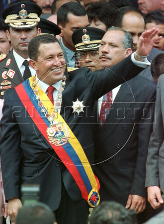 Newly sworn-in President of Venezuela, Hugo Chavez, greets well-wishers during a parade through the streets of downtown Caracas, Venezuela, Tuesday, February 2, 1999. Chavez, 44, a populist, won the election in a landslide victory by largely capitalizing on Venezuelan's anger over declining standards.(Australfoto/Douglas Engle)
