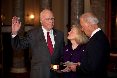 Vice President Joe Biden administers a ceremonial Senate oath during a mock swearing-in ceremony to Senator Patrick Leahy (D-VT), left, accompanied by his wife Marcelle, on Jan. 5, 2011, in the Old Senate Chamber on Capitol Hill in Washington DC. (Photo by Jeff Malet)