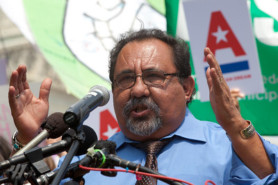 """Rep. Raúl Grijalva (D-AZ) spoke at a rally held outside the Capitol Building in Washington DC on Thursday, July 28, 2011. The rally to """"Save the American Dream"""" was organized to tell Democrats to stand strong against Republican debt ceiling proposals that cut Social Security, Medicare and Medicaid while keeping keep tax breaks for millionaires, billionaires and oil companies. Participants included major labor unions such as AFSCME, CWA, AFGE, Teamsters, and various progressive groups such as Move-On, Rebuild the Dream, Jobs with Justice, Gray-Panthers and Code-Pink. (Photo by Jeff Malet)"""