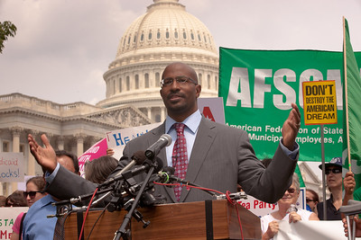 "Former Green Jobs Czar Van Jones was both a featured speaker and emcee at a Rebuild the Dream rally held outside the Capitol Building in Washington D.C.on Thursday, July 28, 2011. Jones pointed out that the mainstream position in America is that rather than looking first to raid programs like Medicaid, we should consider wealthy people part of this country and look to them to help shoulder the burden. The rally to ""Save the American Dream"" was organized to tell Democrats to stand strong against Republican debt ceiling proposals that cut Social Security, Medicare and Medicaid while keeping keep tax breaks for millionaires, billionaires and oil companies. Participants included major labor unions such as AFSCME, CWA, AFGE, Teamsters, and various progressive groups such as Move-On, Rebuild the Dream, Jobs with Justice, Gray-Panthers and Code-Pink. (Photo by Jeff Malet)"