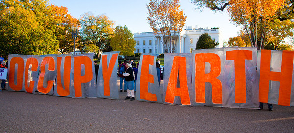 """Occupy Earth"" say the large letters posted in front of the White House. Thousands of protesters opposed to a controversial pipeline project surrounded the White House in Washington DC on Sunday, November 6, 2011. Canadian company TransCanada is seeking permission to build the 1,600-mile (2,700km) Keystone XL pipeline from Alberta to the Gulf coast in Texas. Environmental groups say that extracting oil from the sands would generate huge greenhouse gas emissions, and that any accident on the route could be disastrous. (Photo by Jeff Malet)"