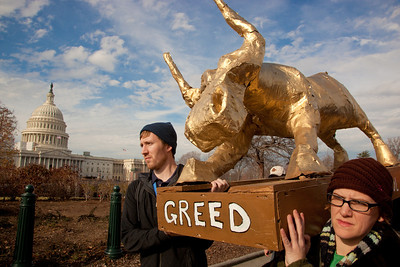 "Occupy DC protesters took their anti-corporate demonstration to Capitol Hill in Washington D.C. on December 15, 2011, carrying a ""golden bull"" to symbolize Congress' subservience to moneyed interests. The paper-mache bull was designed to look like the iconic Wall Street statue in New York's financial district, and is of course an allusion to the biblical ""Golden Calf"". The protest aimed to call attention to the worship of money by the US legislature and called for an end to the influence of big money in politics."