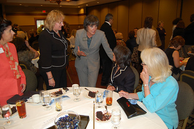 State Representative Julie Hamos discusses issues with Oakton College attendees Carol DiCola, Jillian Verstrate, Hamos, Valerie Green and Barbara Reineking.