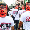 Participants wear pig masks as they march from Fuente Osmeña to Plaza Independencia, during Monday's rally against the abuse of pork barrel funds in Cebu City. (Arni Aclao photo/Sun.Star Cebu)
