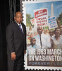 Postal Service Unveils 50th Anniversary of March on Washington Stamp : WASHINGTON — To commemorate the 50th anniversary of the March on Washington for Jobs and Freedom, the U.S. Postal Service unveiled a new Forever stamp at the Newseum on Aug. 23. The stamp completes a series of three that honor the struggle for civil rights in the United States. Actress Gabrielle Union was on hand to add the final photo and unveil the stamp design. The latest stamp is an impressionistic depiction of a diverse group of protesters bearing signs calling for equal rights and jobs with the Washington Monument in the background. The program, hosted by U.S. District Judge Alexander Williams Jr., featured Rep. John Lewis and deputy postmaster general Ronald Stroman, who jointly dedicated the stamp. In 1963, Lewis was chairman of the Student Nonviolent Coordinating Committee and an organizer of the march.