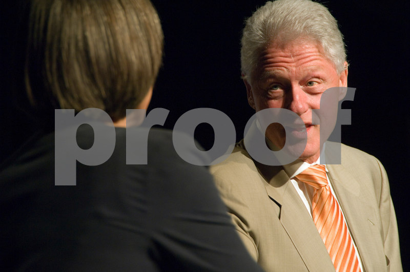 President Clinton acknowledges and shakes hand of his interpreter for the deaf.