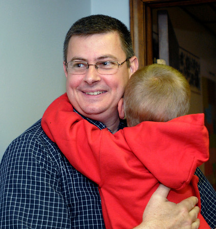 Steve Sumner gets a hug from one of his children after he won his bid for the County Commissioner, middle district seat on the Republican ballot.