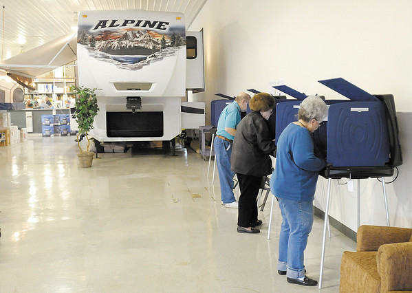 From right, Betty Ewards, Shirley Retherford and Richard Retherford, cast their ballot at precinct 3-5 at Modern Trailer Sales during the primary election on Tuesday.