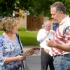 Mike Gaskill talks to voter Donna James at St. Matthew Church during the primary election on Tuesday.
