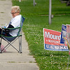 Not many people were outside the polling sites stumping for their favorite candidate this primary with only a handful throughout the city. Michael Widing sits alone outside Main Street Church of God.