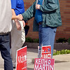 Republican candidate for Middle District County Commissioner Keith Martin greets voters outside of Bethany Christian Church Tuesday where four precincts vote.