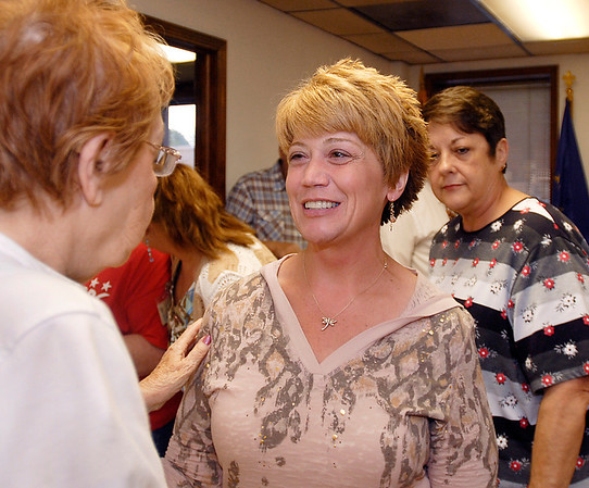 Lisa Phillips gets congratulations after her win for one of the three places for Republican County Council At-Large race.