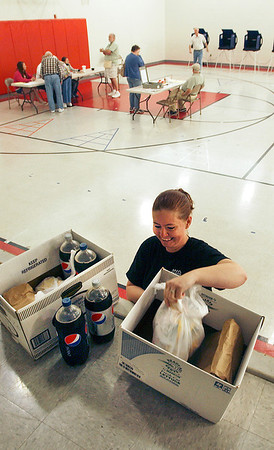 Brandy Powell of Mancino's makes the lunch delivery for the poll workers at Ward 1, precinct 1 and 7 at East Side Intermediate School Tuesday.