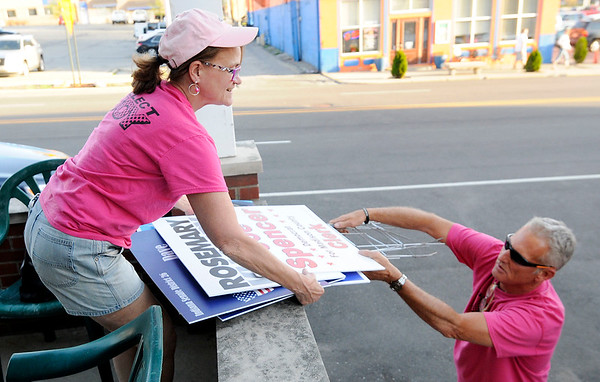 Don Knight   The Herald Bulletin<br /> Dan McLaughlin hands Barbara Joy campaign signs as the unload them at Democratic Headquarters on Tuesday.