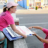 Don Knight | The Herald Bulletin<br /> Dan McLaughlin hands Barbara Joy campaign signs as the unload them at Democratic Headquarters on Tuesday.
