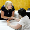 Don Knight | The Herald Bulletin<br /> Terri Austin talks to Mary Moore at Democratic Headquarters on Tuesday.