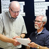 Don Knight | The Herald Bulletin<br /> State Senator Tim Lanane looks over results with Bill Riffe at Democratic Headquarters on Tuesday.
