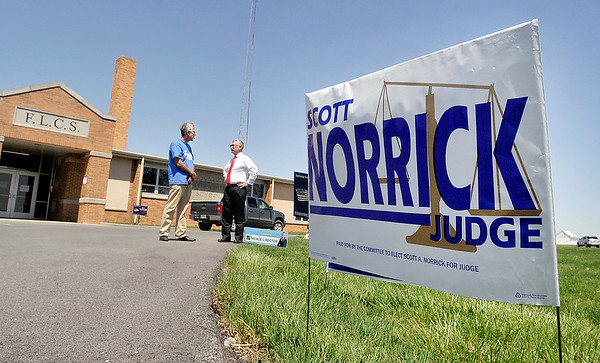John P. Cleary | The Herald Bulletin<br /> Circuit Court, Division 3 Republican candidate, Scott Norrick, talks with Bryce Owens as they wait for voters at Jackson Twp., Precinct 1 located at the Frankton-Lapel School Administration building.