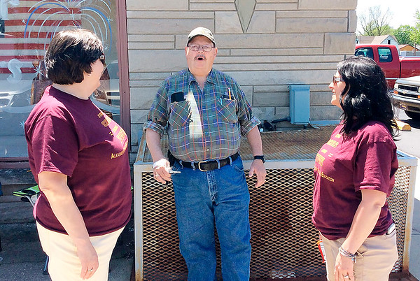 Rebecca Bibbs | The Herald Bulletin<br /> Alexandria Community Schools Superintendent Melissa Brisco talks with Michael Klienefelter and Rachel Robinson outside the polling site at the Eagles Lodge in Alexandria.