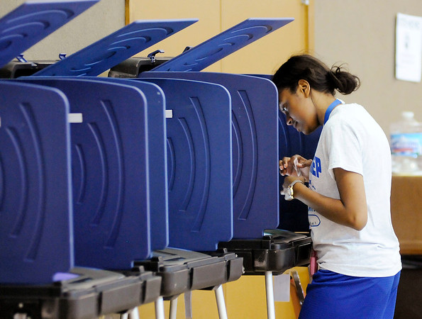 Don Knight   The Herald Bulletin<br /> Angel McClendon votes in her first election at Anderson Zion Baptist Church  on Tuesday.